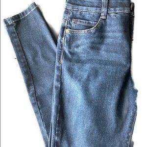 Vintage America dark wash skinny Jean.